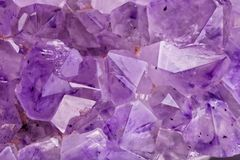 Translucent crystals of a amethyst stone. Detail of the translucent crystals of a amethyst stone stock image