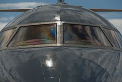 Detail of transport plane. Detail view to transport windshield in dark atmosphere stock images