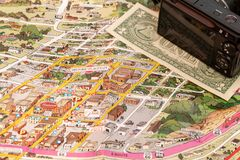 Detail of travel map Flagstaff, Arizona, USA with camera and one Dollar bill. Travel planning and preparation concept royalty free stock photos