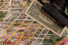 Detail of travel map Flagstaff, Arizona, USA with one Dollar bill just below the couthouse, justice and travel concept. Detail of travel map Flagstaff, Arizona royalty free stock images