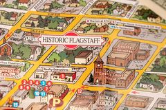 Detail of travel map Flagstaff, Arizona, USA with one Dollar bill just below the couthouse, justice and travel concept. Detail of travel map Flagstaff, Arizona stock photography