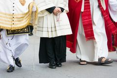 Detail of the trditional dresses of christian confraternity members. During a procession royalty free stock photos