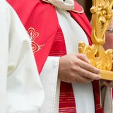 Detail of the trditional dresses of christian confraternity members. During a procession stock image