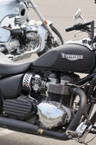 Detail of Triumph motorbike in a parking Stock Photo