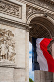 Detail of Triumphal Arch with national flag of France, Paris, Fr. Detail of Triumphal Arch (Arc de Triumphe) wiith national flag of France, Paris Stock Photo