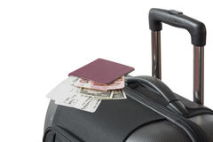 Detail of Trolley suitcase with passport. Detail view of Trolley suitcase with passport flight tickets Euro and US Dollar Banknotes isolated on white background Royalty Free Stock Photos