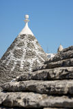 Detail of Trulli house. Focus on background. Royalty Free Stock Images