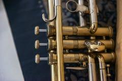 Jazz Trumpet valves. Detail of trumpet closeup. Golden trumpet valves Stock Images