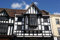 Detail of tudor ancient building. Detail of black and white timber framed tudor period building stratford-on-avon England bright sunlight blue sky Stock Photo