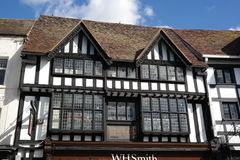 Detail of tudor building. Detail windows and timber frame of ancient tudor building stratord-on-avon England black and white front blue sky Royalty Free Stock Images