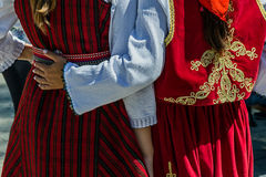 Detail of Turkish and Macedonian folk costumes for women. With multicolored embroidery stock image