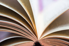 Detail of Turning Over Book Pages Stock Photo