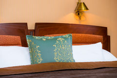 Detail of turquoise pillow on the bed Royalty Free Stock Photography