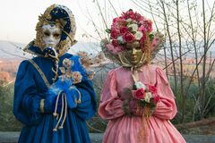 Detail of two beautiful carnival mask with flowers Stock Photos