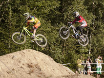 Detail of two bikers on jumps - editorial Royalty Free Stock Images