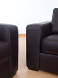 Detail of two brown leather sofas royalty free stock photography