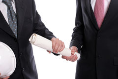 Detail of two business men exchanging new project Stock Photography