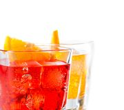 Detail of two cocktail with orange slice isolated on white background Stock Photography