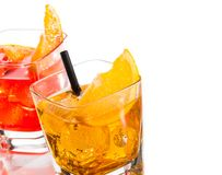 Detail of two cocktail with orange slice on top isolated on white background Royalty Free Stock Images