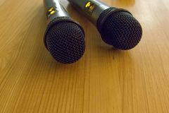 Detail of two hand portaable microphones Royalty Free Stock Images