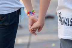 Detail of two holding hands of two young people Stock Images