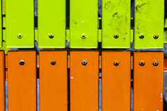 Detail of two lawn chairs in green and orange Royalty Free Stock Photo