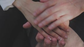 Detail of two lovers joining hands.  stock video footage
