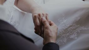 Detail of two lovers joining hands stock video footage