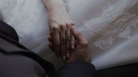 Detail of two lovers joining hands.  stock video