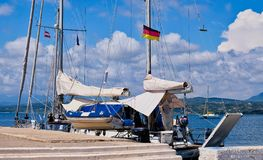 Two Masted Yacht, Pylos, Western Peloponnese, Greece. Detail of a two masted sailing yacht, with furled sails and flying a German flag, docked in Methoni harbour royalty free stock photography