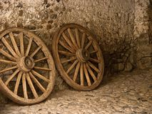 Detail of two old wagon wheels Stock Images
