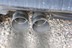 Exhaust system emits dark smoke as exhaust royalty free stock photography