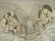 Detail of two sculptures of ecclesiastical men in ornament wall of the Chartreuse of St. Martin in Naples, Italy. White marble sculpures. Travel destination royalty free stock photography