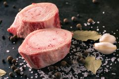 Detail of two slices of marrowbone on black board Royalty Free Stock Photography