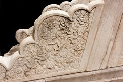 Detail - two stylized dragons - Imperial Palace, Beijing. Detail of stone carving on a staircase in the Imperial Palace, Beijing, China. Note two dragons with up Royalty Free Stock Photo