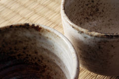 Detail of two teacups. Detail of two handcrafted, Japanese tea cups royalty free stock image