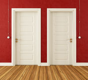 Detail of two white doors. In a red room - rendering Royalty Free Stock Photography