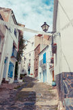 Detail of the typical stone street of Cadaques. Costa Brava. Royalty Free Stock Images