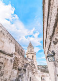 Detail of typical stones (Sassi di Matera) and church of Matera under blue sky Royalty Free Stock Images