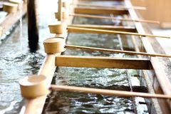 Detail of a typical Temizuya a Shinto water ablution pavilion for a ceremonial purification rite known as temizu. Detail of a typical Temizuya a Shinto water Stock Photos