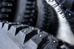 Detail of a tyre with studs. A detail of the tyre with studs used for the rally cars to have a better control on snow and ice Stock Photography