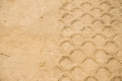 Detail of tyre tracks in sand on building bridge Royalty Free Stock Photography