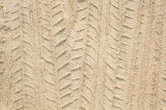 Detail of tyre tracks in sand desert Royalty Free Stock Image