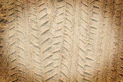 Detail of tyre tracks in sand desert Stock Images