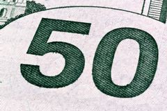 Detail of U.S. fifty dollar bill, isolated end stacked. royalty free stock image