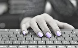 Ultra violet colored nails typewriting royalty free stock photo