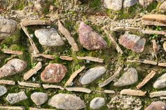 Detail of unusual ancient rock wall design and pattern in Olympia Greece where the first Olympics were held. Detail of an unusual ancient rock wall design and Royalty Free Stock Photography