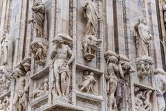 Detail of upper section of the Duomo di Milano populated with statuary. The Duomo di Milano has more statues attached to the building than any other in the Stock Photos