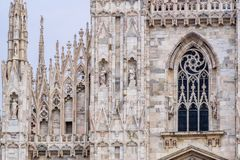 Detail of upper section of the Duomo di Milano populated with statuary. The Duomo di Milano has more statues attached to the building than any other in the world Royalty Free Stock Images