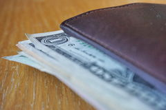 Detail of the US dollars, bank notes inserted in the leather wallet Stock Photography